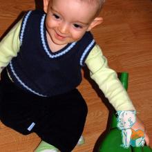 copil cu stropitoare